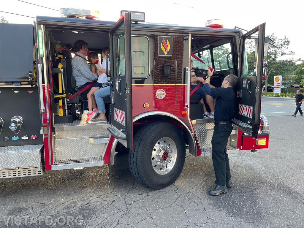 """Members getting fire truck rides on Engine 141 at the """"Tunnel to Towers Foundation"""" Fundraiser"""