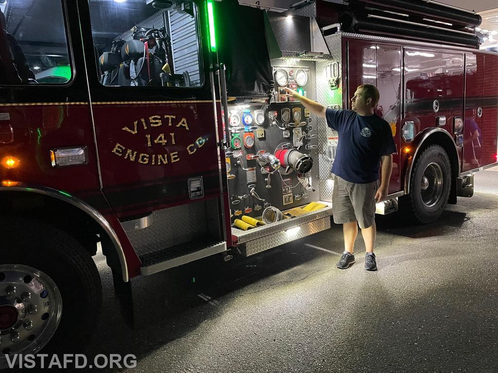 Assistant Chief Mike Peck going over the equipment on Engine 141