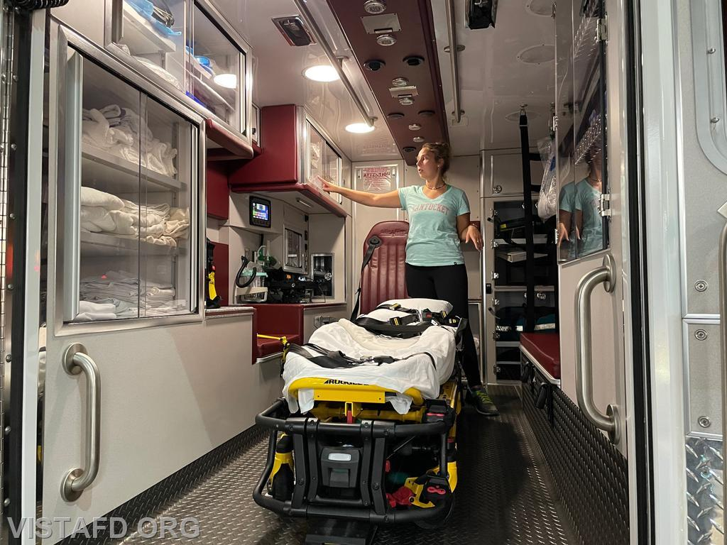 Foreman Elly Hersam going over the equipment on Ambulance 84B1