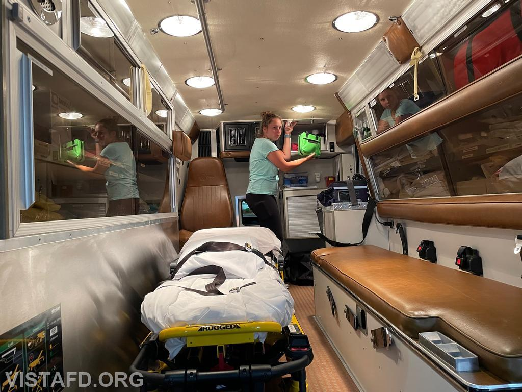Foreman Elly Hersam going over the equipment on Ambulance 84B2