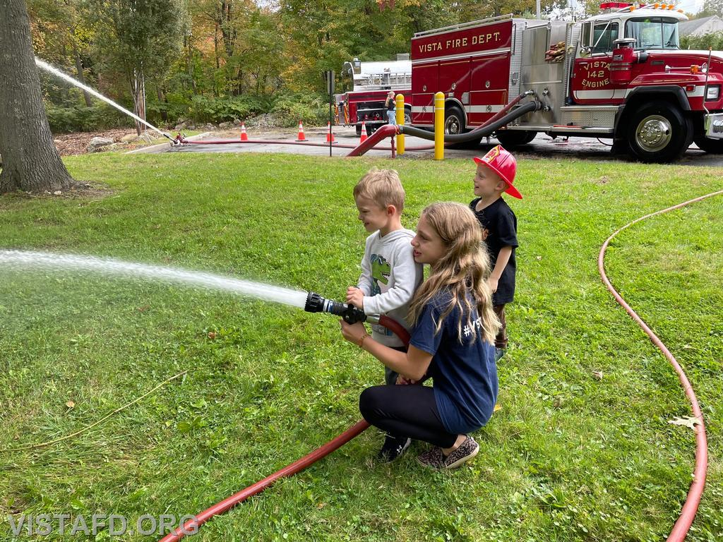 Junior Firefighters practice operating a hoseline during the 2021 Vista Fire Department Open House