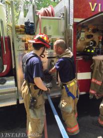 Lt. Brian Porco instructs Foreman Phil Katz on the E-142 pump panel