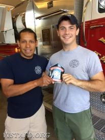 FF Mike Canil receives his Firefighter shield from his mentor Lead Foreman Wilmer Cervantes