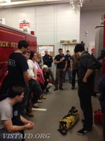 Foreman Brian Porco leads a review of Engine 141 with all of our members