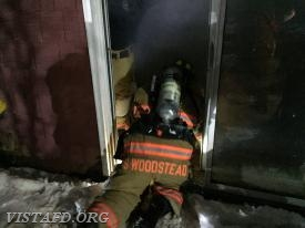 Firefighter Steve Woodstead makes entry into the acquired structure to begin search and rescue operations