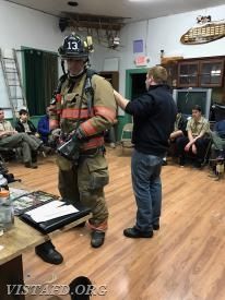 Captain Mike Peck and Foreman Marc Baiocco go over their Firefighting gear