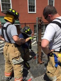 """Lead Foreman Baiocco & FF Blasco practicing the """"through the lock"""" forcible entry method"""