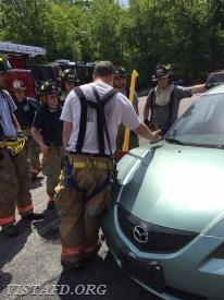 FF Sean Kelly reviewing how to prop open the hood of a car