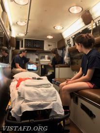 Capt. Ferman & Foreman Lilly reviewing where equipment is located on Ambulance 84B2