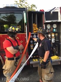 Capt. Mike Peck reviewing the Engine 141 pump panel with FF/EMT Candidate Dan Castelhano