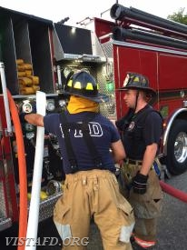FF Martin Rojas practices operating the Engine 141 pump panel as Capt. Mike Peck looks on