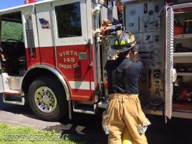 Foreman Mike Canil operating the Engine 143 pump panel