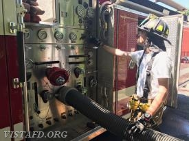 Foreman Adam Bartley operating the E-143 pump panel