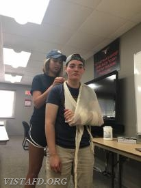 Probationary EMT Candidate Olivia Buzzeo practices the sling and swathe procedure