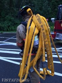 "Probationary FF Patrick Healy stretching the 1-3/4"" hoseline off of Engine 141"