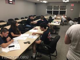 Vista EMTs & EMT Candidates go through call scenarios and writing a mock PCR