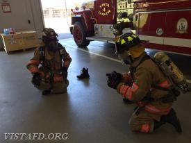 "FF Ryan Ruggiero and Probationary FF Finn Brannan performing the ""2-minute drill"""