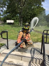 "Firefighter Patrick Healy and Probationary FF Finn Brannan practice operating an 1-3/4"" hose line"