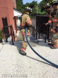 "FF Ryan Ruggiero practicing 1-3/4"" hose line advancement as Lt. Phil Katz & Lead Foreman Marc Baiocco look on"