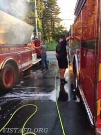 FF Brendan Tobin cleaning Tanker 4 while Lead Foreman Marc Baiocco cleans Engine 141