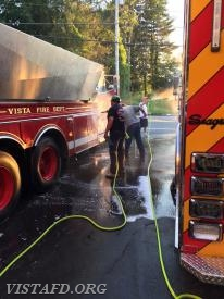 FF Martin Rojas washes off Tanker 4 while Lt. Phil Katz washes off Engine 141