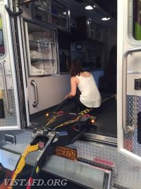 Probationary EMT Candidate Jasmine Lilly cleaning the cab of Ambulance 84B1