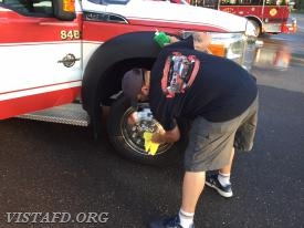 EMT Candidate Greg Pastrana cleaning Ambulance 84B1