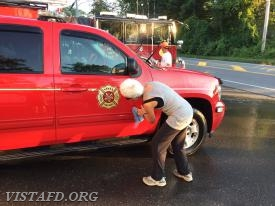 FF Lynda Scott cleaning the Chief's Car