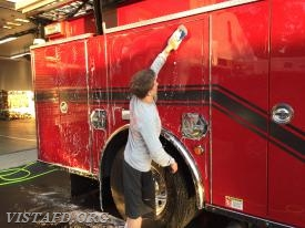 Probationary FF Finn Brannan cleaning Engine 141