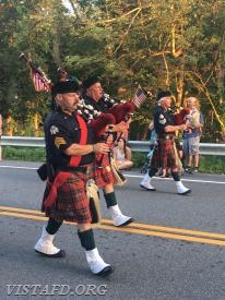 Ex-Chief Bill Dingee playing the bagpipes during the 2017 South Salem Fire Department Parade