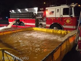 New Canaan Tanker 8 dumping water in the portable ponds during the Pound Ridge Water Supply Drill