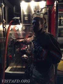 "Foreman Adam Bartley operating the E-143 pump panel during ""MPO & Firefighter Fundamentals"" class"