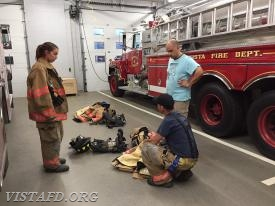 Lt. Katz & Foreman Castelhano show Probationary FF/EMT Candidate Buzzeo how to put on Firefighting gear
