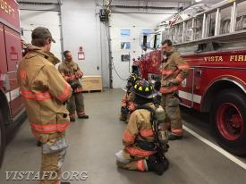 "Lt. Phil Katz going over how to put on Firefighting gear during ""MPO & Firefighter Fundamentals"" class"