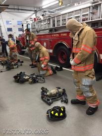 "Vista Firefighters performing a ""2-minute donning drill"" during ""MPO & Firefighter Fundamentals"" class"