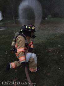 "FF Patrick Healy & Foreman Dan Castelhano operating an 1-3/4"" hose line"