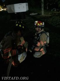 "Lt. Phil Katz going over how to operate an 1-3/4"" hose line with Probationary FF/EMT Candidate Olivia Buzzeo"
