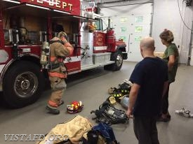 "Lt. Phil Katz reviewing how to properly put on Firefighting gear during ""Firefighter Fundamentals Class"""