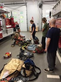 "Lt. Phil Katz reviewing how to operate an SCBA during ""Firefighter Fundamentals Class"""