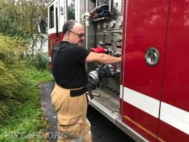 "Firefighter Mark Albert operating the Engine 143 pump panel during ""MPO Class"""