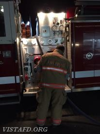 Firefighter Mark Albert operating the Engine 143 pump panel