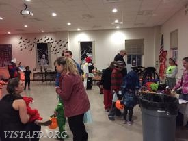 Trick or treaters visiting the Vista Firehouse