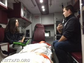 Foreman Mike Canil reviewing various equipment on Ambulance 84B1 with Probationary EMT Candidate Jasmine Lilly