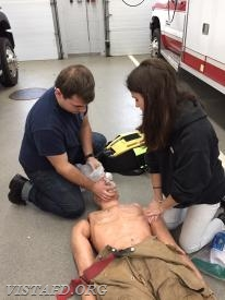 "Foreman Canil showing Probationary EMT Candidate Lilly how to use a bag-valve mask during ""EMT Fundamentals Class"""