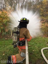 "Firefighter Ryan Ruggiero practices operating the 1-3/4"" fog nozzle"