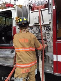 "Firefighter Patrick Healy practices operating the E-142 pump panel during ""MPO & Firefighter Fundamentals Class"""