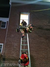 Vista Firefighters performing a head first ladder bailout