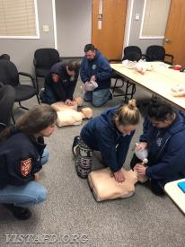 "Vista members practice CPR during the ""AHA CPR Class"""
