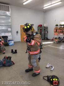 "Probationary FF Olivia Buzzeo performing a ""2-minute drill"" during ""Firefighter Fundamentals Class"""
