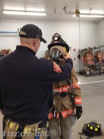 "Lead Foreman Marc Baiocco checking Probationary FF Olivia Buzzeo's gear following completing of the ""2-minute drill"""